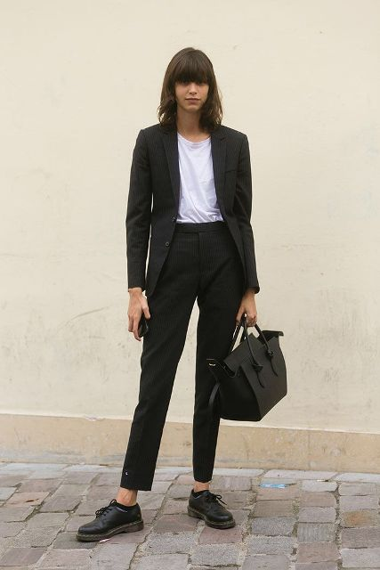 With white t-shirt, suit and black bag