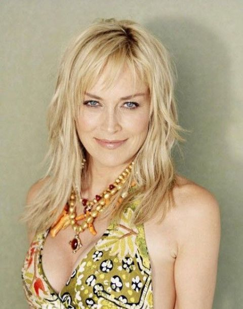 Picture Of blonde layered straight long hair with bangs