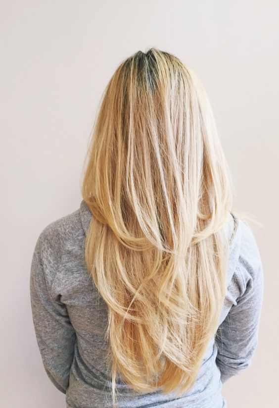 layered long beige-blonde straight hair in a V shape