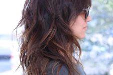 medium length layered hair with caramel highlights