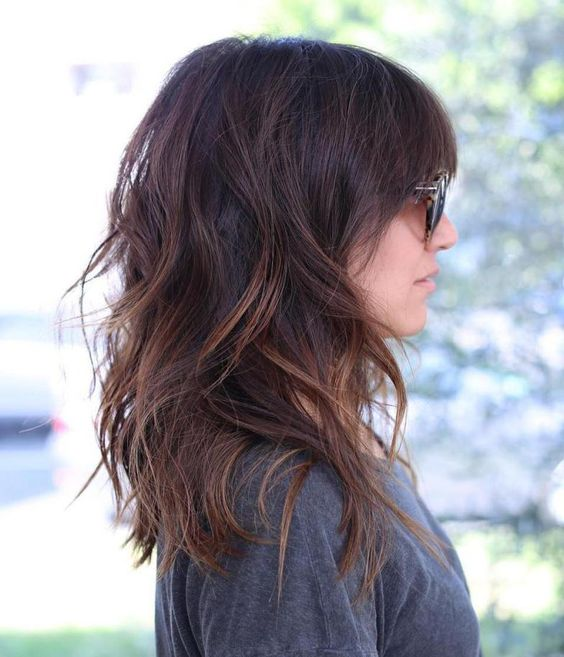 Picture Of Medium Length Layered Hair With Caramel Highlights