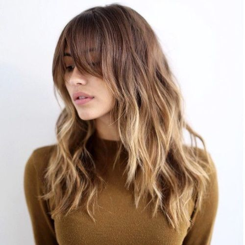 off center bangs, long layers and pretty, loose waves
