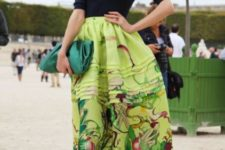 02 a navy shirt, red booties, an emerald clutch and a printed greenery skirt