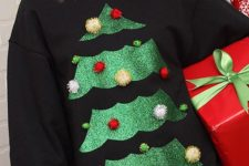 02 black sweater with a glitter tree and pompom ornaments