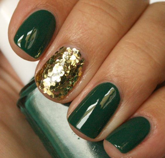 emerald nails with a gold sequin accent