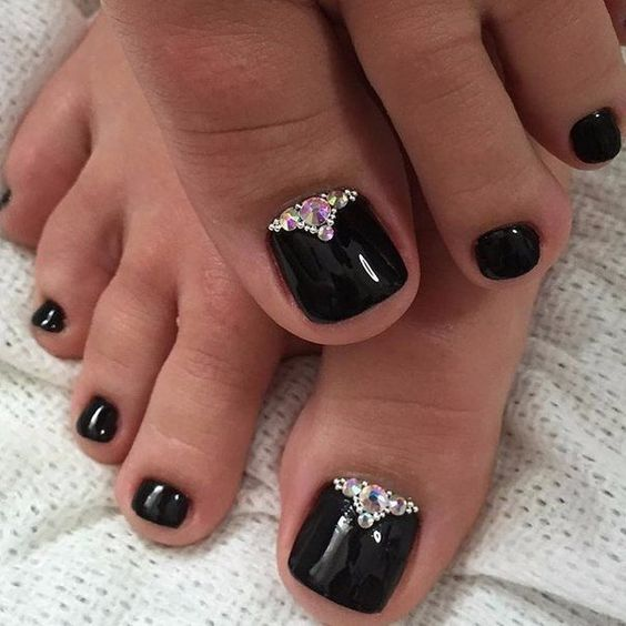 black pedicure with rhinestones