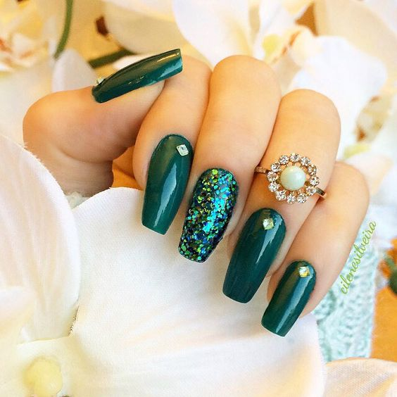 emerald nails with a green sequin accent and gems