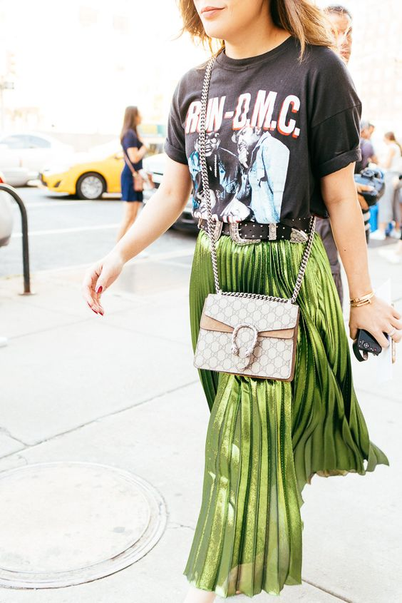 pleated greenery skirt with a printed rock tee and a corssbody bag