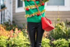 05 emerald sweater with a sparkly garland and red ornaments