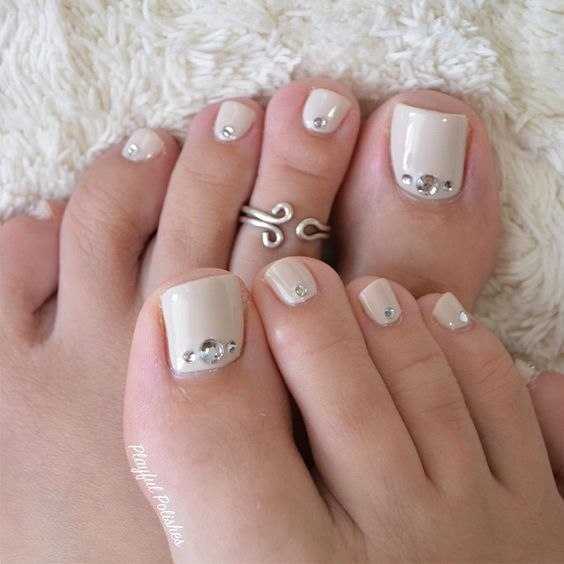 cream nails with rhinestones