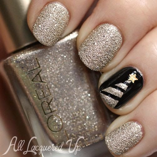 pearl colored glitter nails and a black accent nail with a tree
