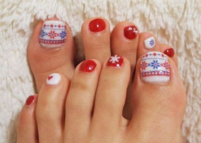 red anils and an accent nail with Scandinavian patterns