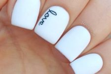 07 white nails with letters written with a sharpie