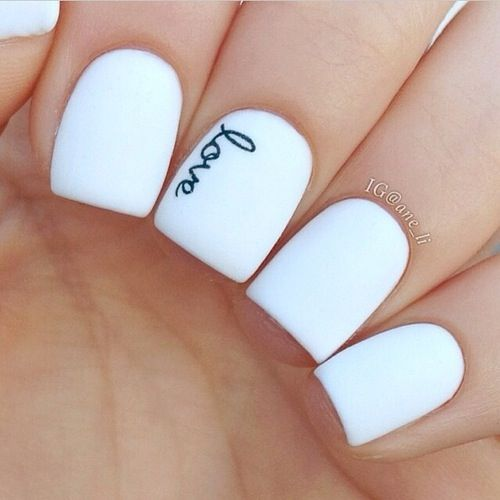 white nails with letters written with a sharpie