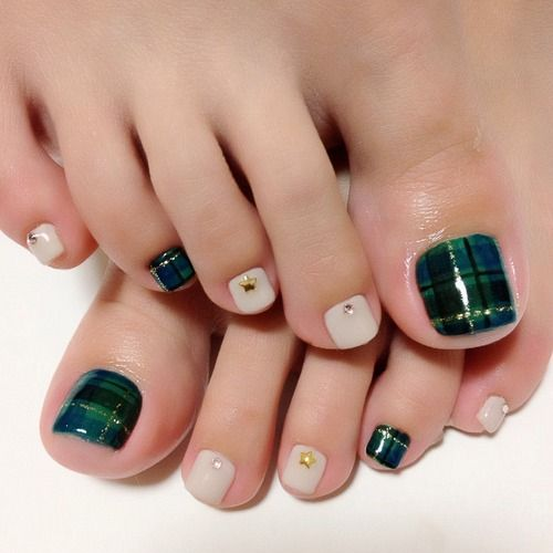 white nails with studs and an emerald plaid accent nail