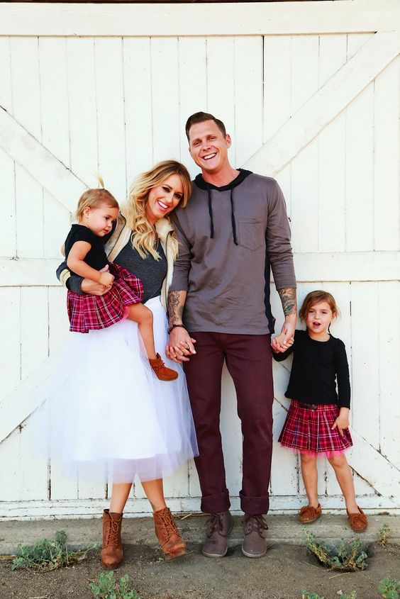 daughters in the same outfits with plaid skirts and black long sleeves