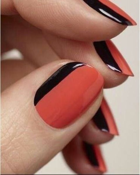 red nails with black sides made with a black sharpie