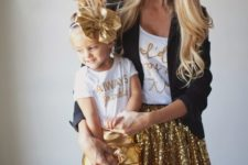 09 gold calligraphy t-shirts, a gold sequin skirt and a black jacket for the mom, metallic gold shorts for the girl