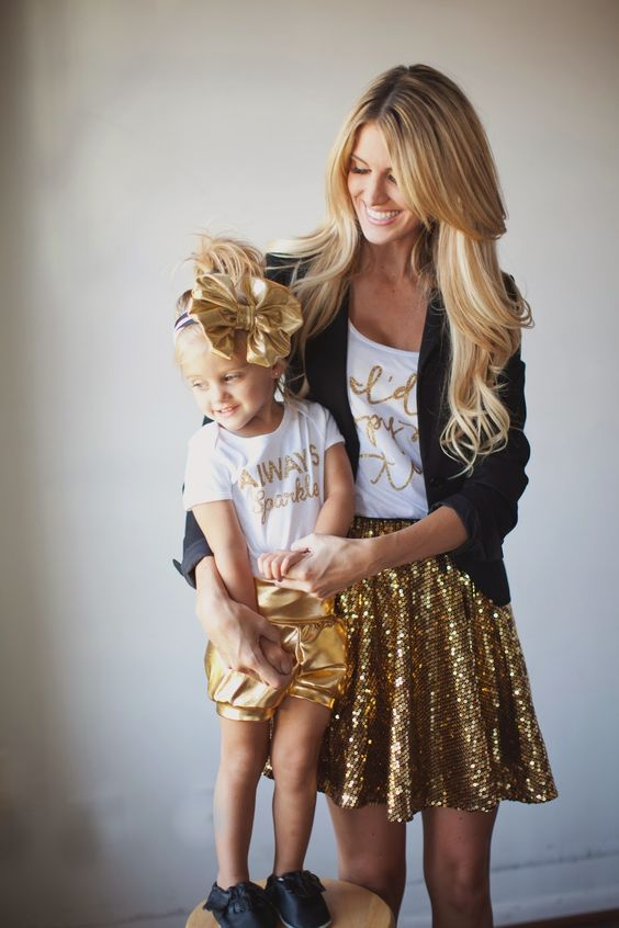 gold calligraphy t-shirts, a gold sequin skirt and a black jacket for the mom, metallic gold shorts for the girl