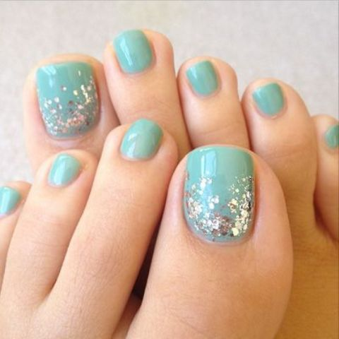 aquamint toe nails with a touch of glitter - 19 Cute Toe Nail Designs For Winter - Styleoholic