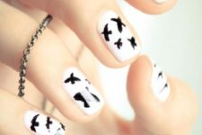 11 white nails with black birds