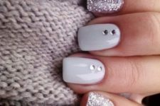11 white nails with rhinestones and glitter silver nails