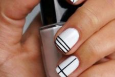 12 white nails with black geometric design