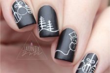 13 black nails with white decor, different on each nail