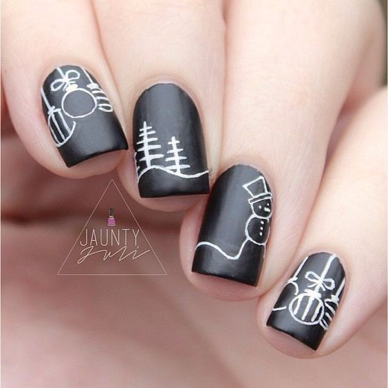 black nails with white decor, different on each nail