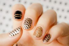 13 gold and gold glitter nail art with patterns made with a black sharpie