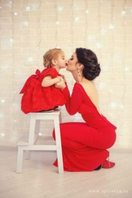 red dresses   a backless for the mom and a ball gown for the daughter