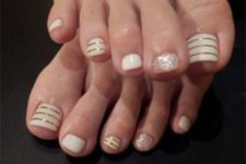 13 white toes with glitter and gold stripes