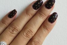 14 burgundy nails with gold polka dots