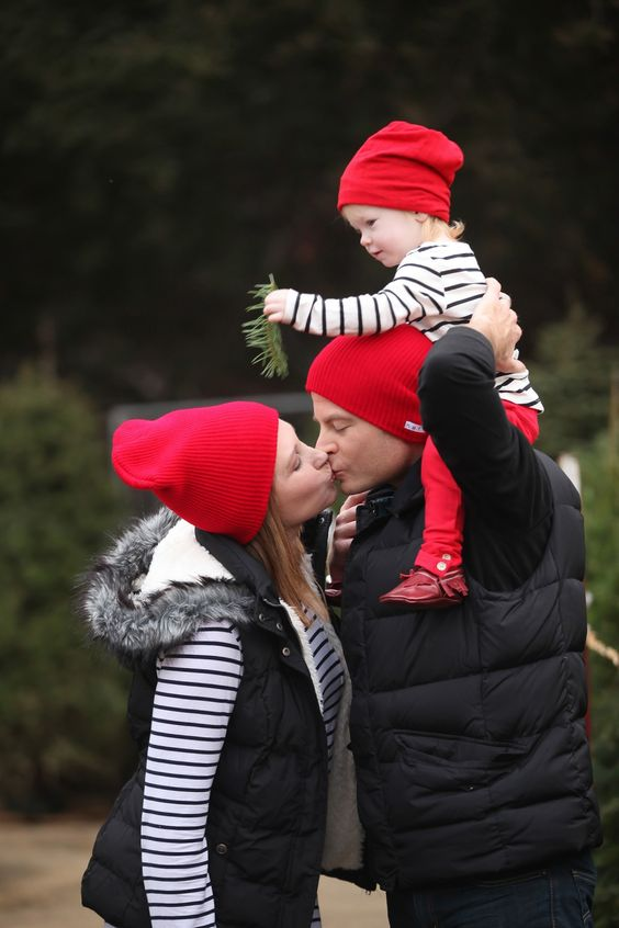 red hats for everyone, quilted vests and striped shirts