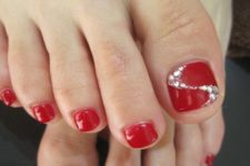 14 red nails with glitter accents
