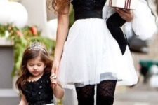 14 tulle skirts, beaded tops, black tights and shoes for the mom and the daughter
