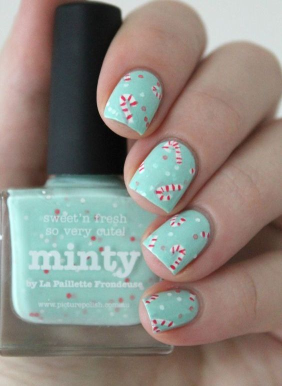 chic mint nails with a candy cane pattern