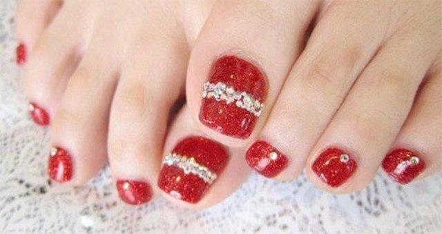 red pedicure with rhinestones