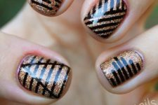 16 copper glitter nails with black decor made with a sharpie