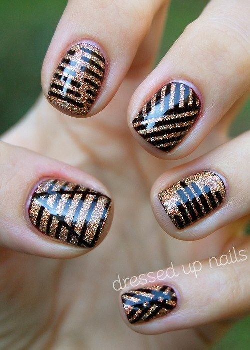 copper glitter nails with black decor made with a sharpie