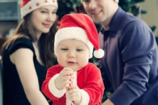18 Santa hats for parents and a Santa costume for the child