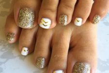 18 gold glitter and white nails with gold chevrons