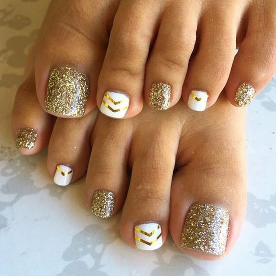 gold glitter and white nails with gold chevrons
