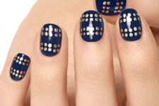18 navy nails with gold polka dots made with a sharpie