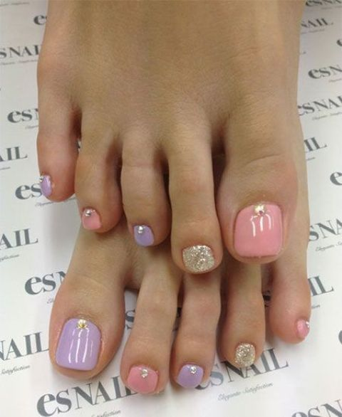 pastel nails with glitter and beads for a girlish look