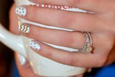 20 whie nails with various patterns made with a gold sharpie