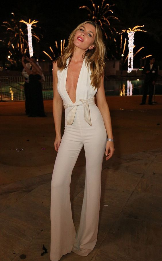 white jumpsuit with a plunging neckline