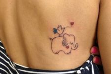 Baby elephant with bird on the back