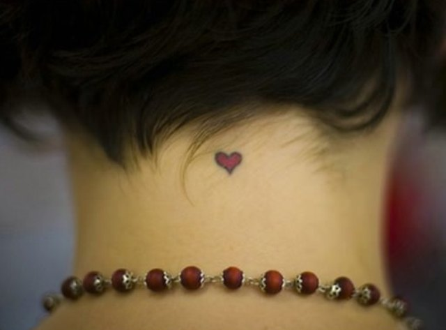 Back neck heart tattoo