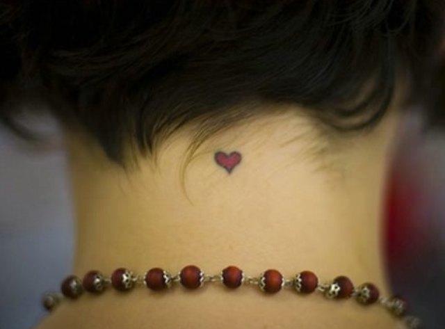 Back neck heart tattoo